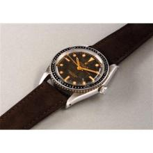 ROLEX - An extremely rare and attractive stainless steel diver's wristwatch with honeycomb dial and center seconds, 1953