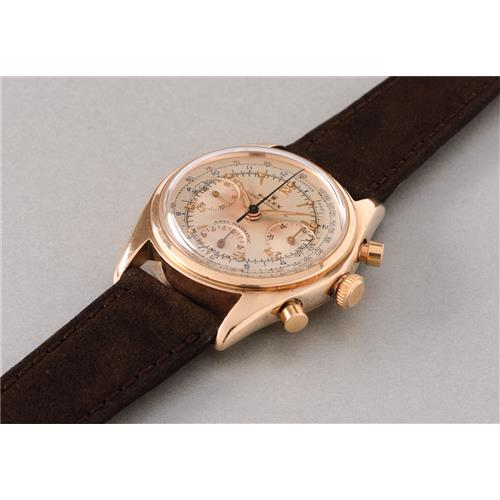ROLEX - A fine and exceedingly rare gold chronograph wristwatch, with presentation box and service warranty, 1947