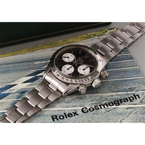 ROLEX - A rare and highly attractive stainless steel chronograph wristwatch with black 'Sigma' dial and bracelet, 1972
