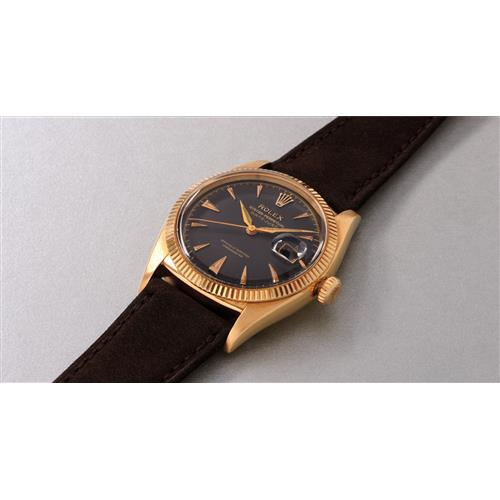 ROLEX - A rare and attractive yellow gold wristwatch with black dial and date, 1955