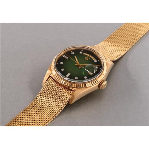 ROLEX - A fine and rare yellow gold and diamond-set calendar wristwatch with center seconds, green lacquer dégradé dial and bracelet, 1970