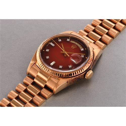 ROLEX - A rare and attractive pink gold and diamond-set calendar wristwatch with bracelet and burnt orange lacquered dégradé dial, 1977
