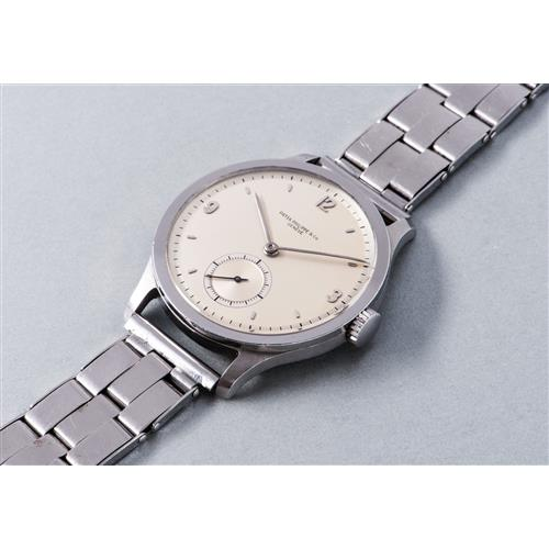 PATEK PHILIPPE - An extremely rare, oversized stainless steel wristwatch with subsidiary seconds and bracelet, 1946