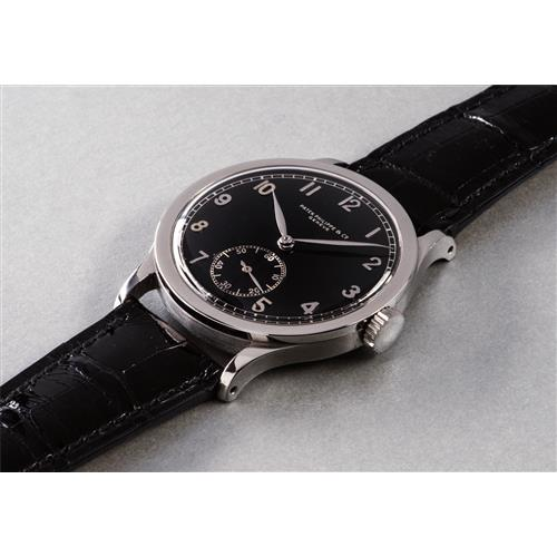 PATEK PHILIPPE - An extremely  rare and highly attractive oversized stainless steel wristwatch with black lacquer telephone dial, 1942