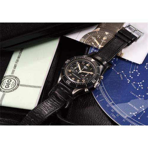 HEUER - A very rare and attractive stainless steel military issued fly-back chronograph wristwatch accompanied by a portfolio of astronomical calculations and sky chart, 1968