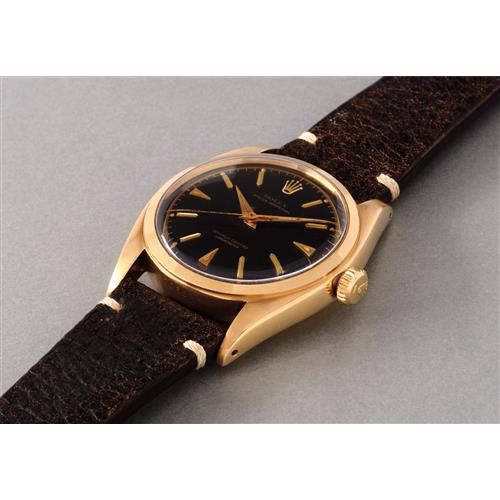 ROLEX - A rare and very attractive yellow gold wristwatch with black dial, 1951