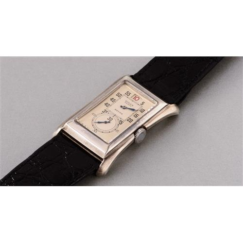 ROLEX - A very well preserved and rare silver rectangular doctor's wristwatch with red jump hour and two-tone silvered dial, retailed by Beyer, circa 1930