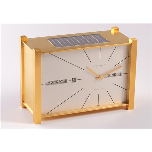 PATEK PHILIPPE - A fine and very rare solar-powered gilt brass table clock with perpetual calendar, retailed by Tiffany & Co., 1964