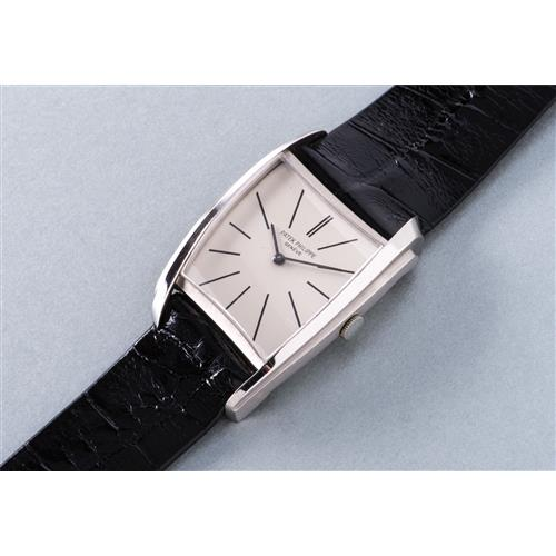 PATEK PHILIPPE - An extremely rare and possibly unique white gold asymmetrical wristwatch, designed by Gilbert Albert, 1958