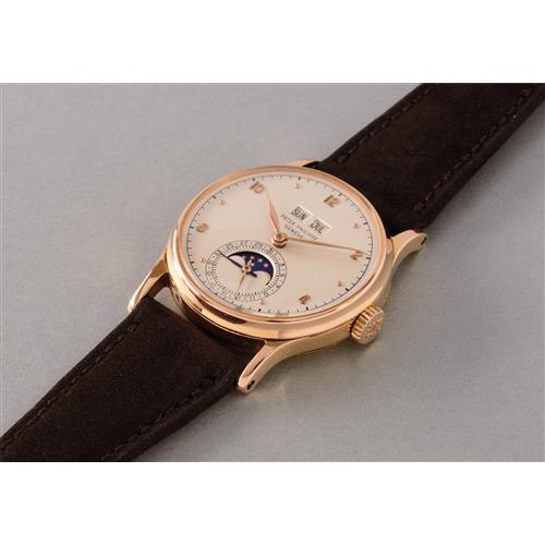 PATEK PHILIPPE - An very attractive and extremely rare pink gold perpetual calendar wristwatch with phases of the moon, 1949