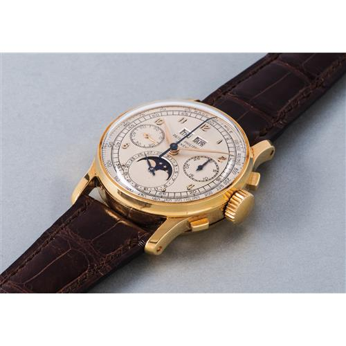 PATEK PHILIPPE - An exceptional and extremely rare gold perpetual calendar chronograph wristwatch with moon phases, 1951