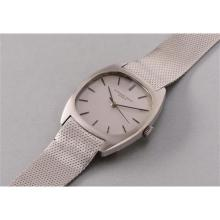 AUDEMARS PIGUET - A rare stainless steel tonneau-shaped wristwatch with center seconds and mesh bracelet, 1972