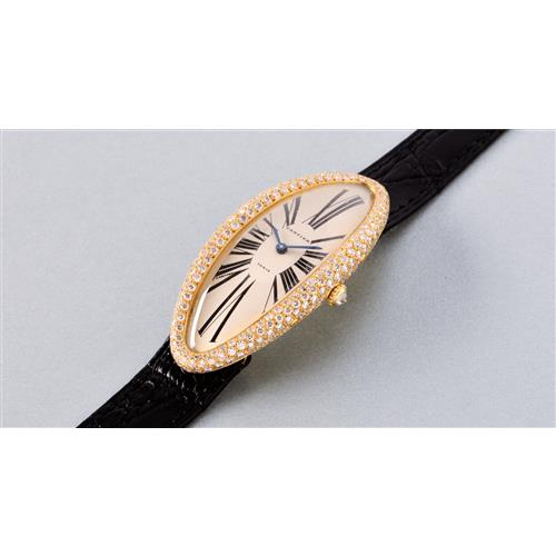 CARTIER - A fine and rare yellow gold and diamond-set elongated oval ladyÕs wristwatch, circa 1990