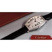 CARTIER - A fine and attractive tonneau-shaped white gold and diamond-set wristwatch, 1995