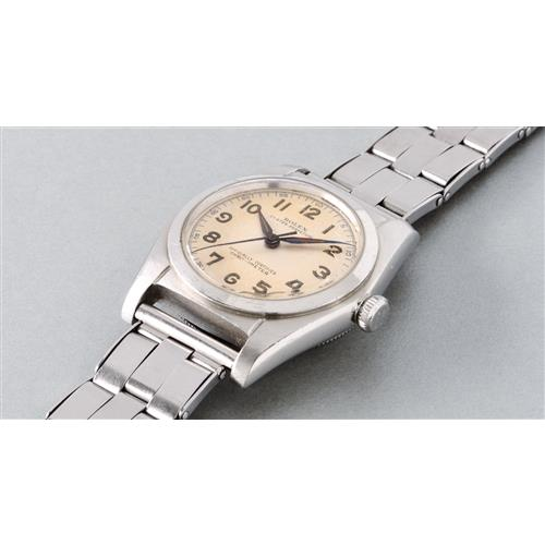 ROLEX - A fine and attractive stainless steel automatic wristwatch with luminous Arabic numerals and Gay Frres bracelet, 1946