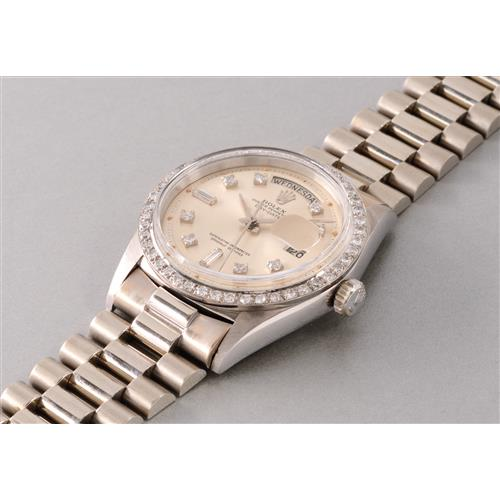 ROLEX - A very fine, rare and attractive white gold calendar wristwatch with diamond-set bezel, hour markers and bracelet, 1965