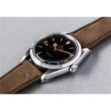 ROLEX - An extremely rare and highly attractive stainless steel wristwatch with black dial, engraved