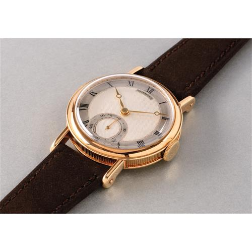 BREGUET - An attractive and rare yellow gold wristwatch with guillochŽ dial, 1955