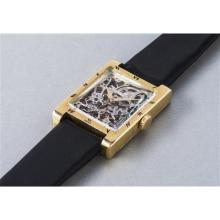 AUDEMARS PIGUET - A very rare and elegant yellow gold rectangular skeletonized wristwatch with black enameled Roman numerals, 1953