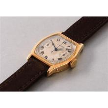 CARTIER - An attractive and extremely rare yellow gold single button chronograph wristwatch, 1929