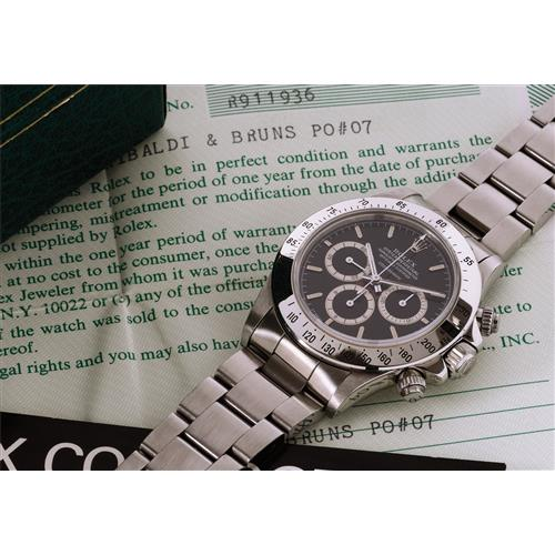 ROLEX - A rare and very attractive stainless steel chronograph wristwatch with black dial, bracelet and certificate, 1988