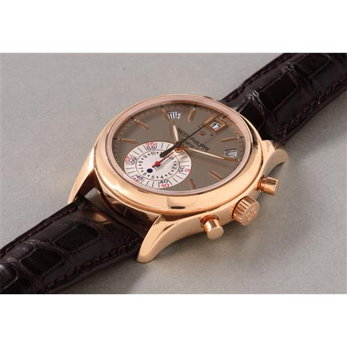 PATEK PHILIPPE - A rare and attractive pink gold chronograph wristwatch with annual calendar, power reserve indication, original certificate and box, 2009