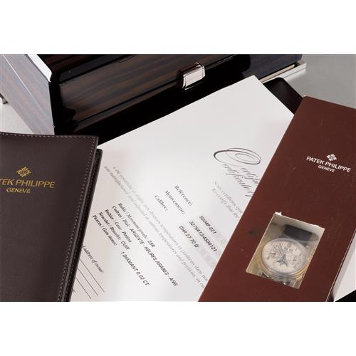 PATEK PHILIPPE - A very attractive and rare platinum perpetual calendar split-seconds chronograph wristwatch with moonphases and leap year indicator, accompanied by presentation box and Certificate of Origin, 2011
