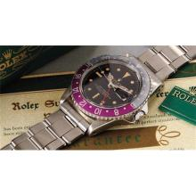 ROLEX - A very rare, early and attractive stainless steel dual time zone wristwatch with black glossy