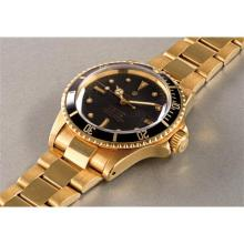 ROLEX - A very well preserved and attractive yellow gold wristwatch with date, center seconds and bracelet, 1972