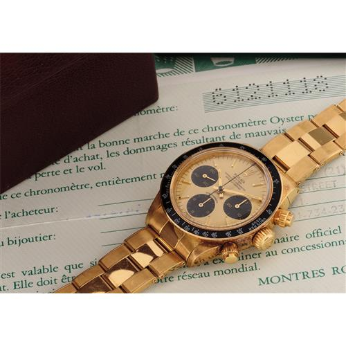 ROLEX - A very attractive and rare yellow gold chronograph wristwatch with guarantee, invoice and box, 1979