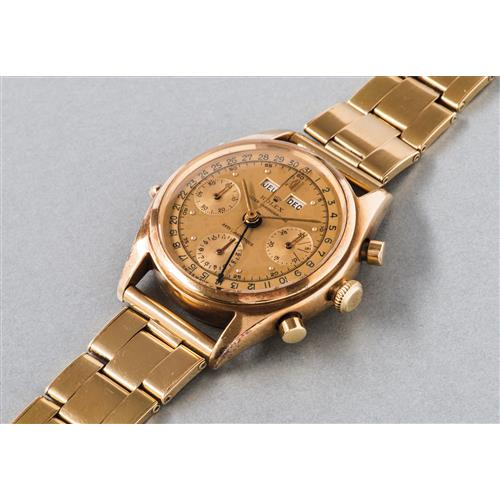 ROLEX - An extremely rare and highly attractive yellow gold triple calendar chronograph wristwatch with two-tone gold dial and bracelet, 1949