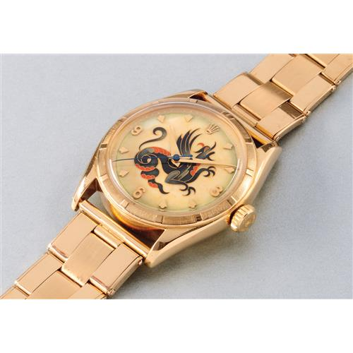 ROLEX - A highly important and most attractive yellow gold wristwatch with cloisonnŽ enamel dial depicting a Dragon, 1952