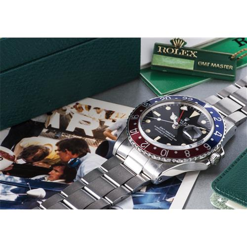 ROLEX - A historically interesting stainless steel wristwatch presented to motorsport designer and constructor Derek Gardner by race legend and Rolex ambassador Sir Jackie Stewart, with bracelet, dual-time zone, accompanied by presentation box, punch