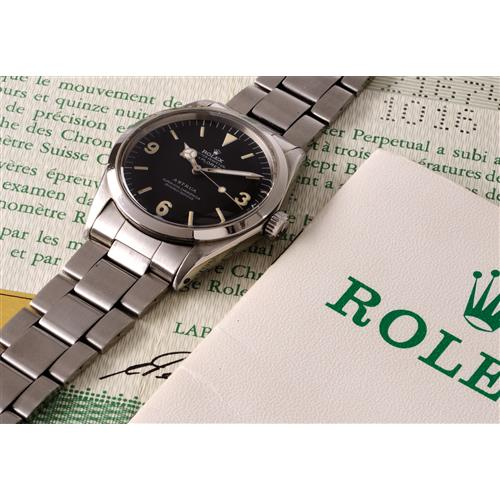 ROLEX - A very rare and attractive stainless steel wristwatch with black dial and certificate, retailed by Astrua, 1969