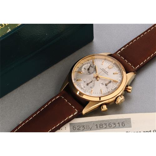 ROLEX - A fine and attractive yellow gold chronograph wristwatch with original guarantee, 1968