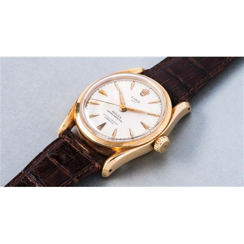 ROLEX - A fine yellow gold wristwatch with honeycomb dial and center seconds, retailed by Linz, 1951