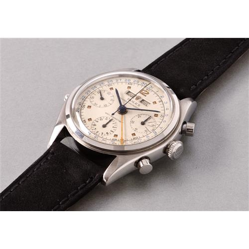 ROLEX - A rare and attractive stainless steel chronograph wristwatch with day, date, and month indication, Circa 1949