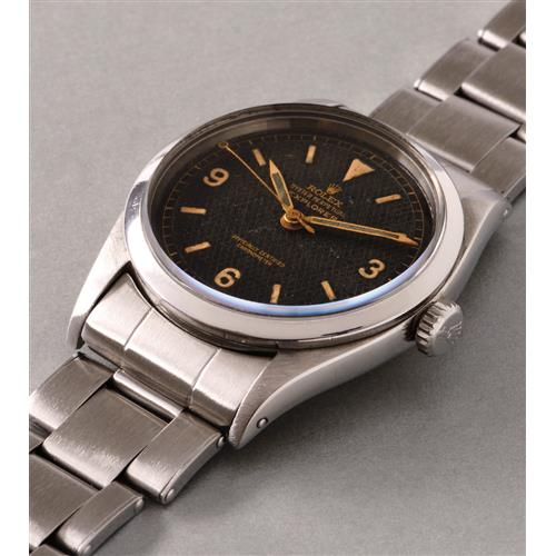 ROLEX - An early and rare stainless steel wristwatch with black honeycomb dial, center seconds and bracelet, 1953