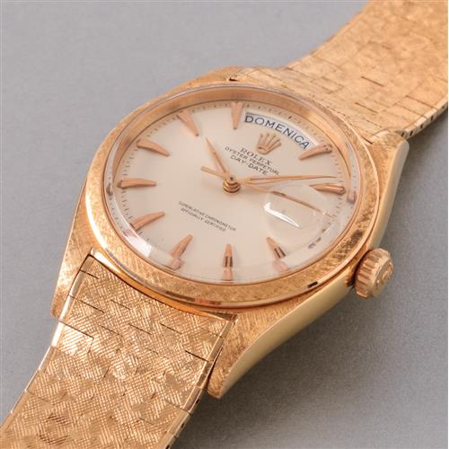 ROLEX - A fine and rare pink gold calendar wristwatch with center seconds and rare textured bracelet, 1960