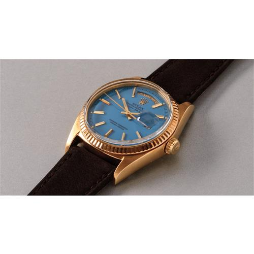 ROLEX - A very fine and rare yellow gold calendar wristwatch with light blue colored lacquered ÒStellaÓ dial, 1973