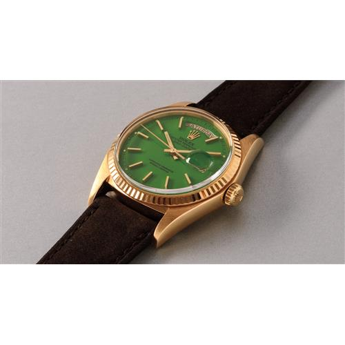 ROLEX - A very fine and rare yellow gold calendar wristwatch with center seconds and pistachio-colored lacquered ÒStellaÓ dial, 1975