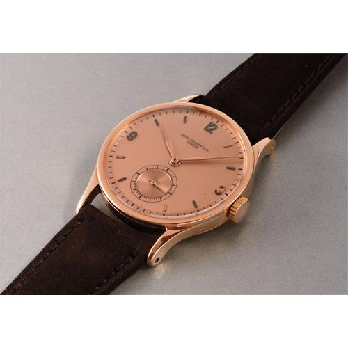 PATEK PHILIPPE - A very rare and large pink gold wristwatch with two-tone pink dial, 1943