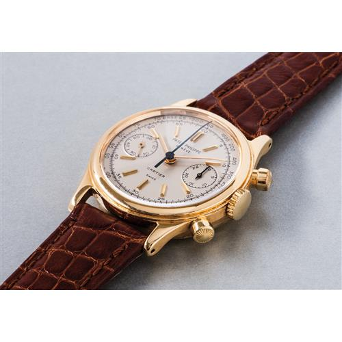 PATEK PHILIPPE - A very exclusive and highly attractive yellow gold chronograph wristwatch with silvered dial, gold hour markers and tachymeter scale, retailed by Cartier, 1968