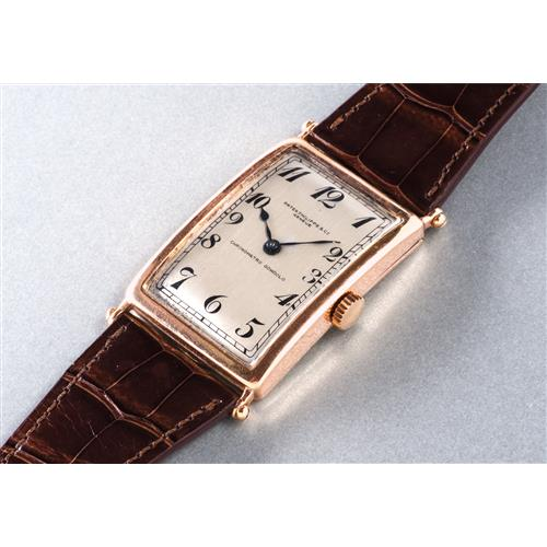 PATEK PHILIPPE - An extremely fine and possibly unique pink gold oversized rectangular hinged wristwatch with Breguet numerals, retailed by Gondolo & Labouriau, 1913 / 1928