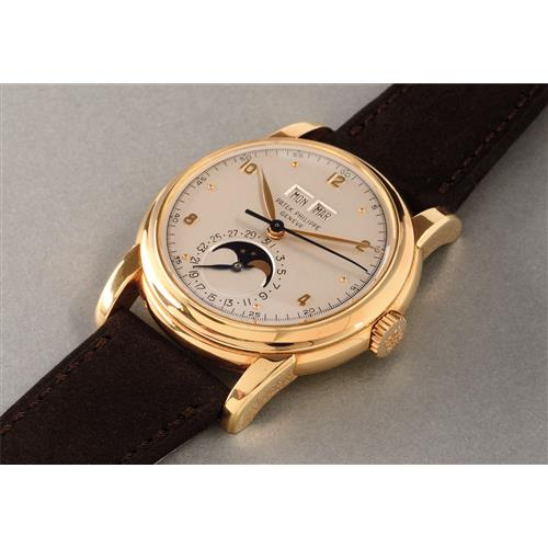 PATEK PHILIPPE - A very rare and highly attractive yellow gold perpetual calendar wristwatch with moonphases and sweep center seconds, 1953