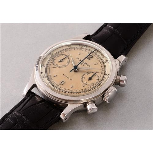 PATEK PHILIPPE - An extremely rare and highly attractive stainless steel chronograph wristwatch with two tone silvered dial with tachymeter scale, retailed by E. GŸbelin, 1946