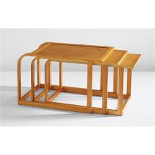 "EVA LISA (PIPSAN) SAARINEN SWANSON AND J. ROBERT F. SWANSON - Rare complete set of three nesting tables, from the ""Flexible Home Arrangements"" line, circa 1940"