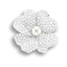 CARTIER - A Cultured Pearl and Diamond 'Flower' Brooch, Cartier