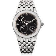 PATEK PHILIPPE - A stainless steel wristwatch with power reserve, moon phases and bracelet, 2000