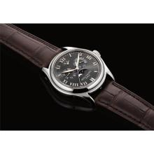 PATEK PHILIPPE - A fine platinum annual calendar wristwatch with sweep centre seconds, power reserve and moon phases, 1999